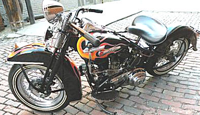 ALL original 1949 Harley Flathead 45 black with a custom motorcycle paint job.