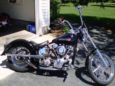 1950 Harley Davidson FL Panhead w rigid Santee wishbone motorcycle frame, a Harley Wide glide front end, HD heads and cases, a Midwest 4 speed transmission, disc brakes, a 3 inch open belt primary and an S&S carb (this photo is for example only; please contact seller for pics of the actual motorcycle for sale in this classified)