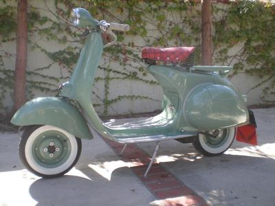 1958 classic restored Vespa scooter, 125cc of refurbished, rebuilt perfection.