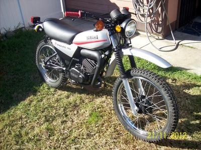 The 1979 Yamaha DT175 MX dirt bike runs fast, has New grips and levers and is great for camping