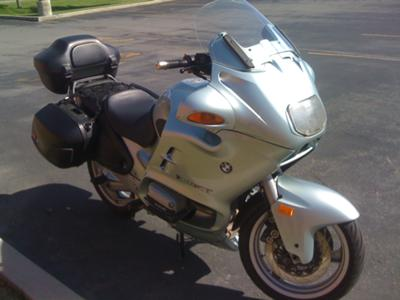 Silver 1998 BMW RT1100 motorcycle with side and top cases