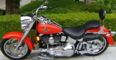Red, Custom 1998 Harley Davidson Fatboy w Thunder Header Exhaust, Running Lights in Front, Chrome Uppers and Lower Belt, Braided Cables, Extra Seat, Sissy Bar, Arlen Ness Wheels, Highway Floor Boards