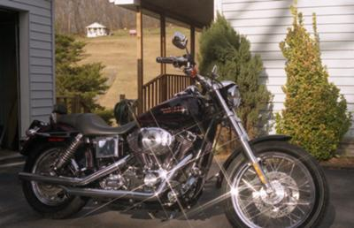 2002 Harley Davidson Lowrider Rider FXDL 1450. Black with red stripes (this photo is for example only; please contact seller for pics of the actual motorcycle for sale in this classified)