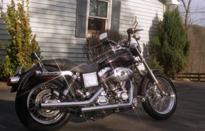 2002 Harley Davidson Lowrider Rider FXDL 1450. Black with red stripes (this photo is for example only; please contact seller for pics of the actual motorcycle for sale in this classified) Vance and Hines exhaust