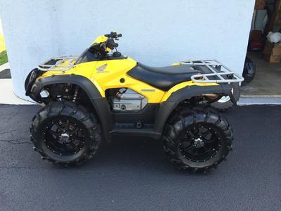 Yellow 2004 Honda Rincon 650 ATV quad