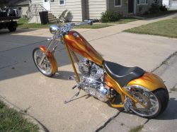 2005 American Ironhorse LSC Chopper 111 Cubic Inch STS motorcycle and Pagan Gold motorcycle paint with Orange Flames