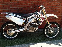 not too good of a pic of the 2005 Honda CRF450r but call for questions