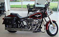 2006 red and black two tone burgundy metallic Harley Davidson Fat Boy Touring Softail
