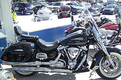 2006 Road Star Silverado w Raven lacquer paint job, chromed front end, studded touring saddle with backrest and Midnight trim adjustable windshield