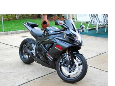 2007 Suzuki GSXR painted all black with frame sliders (not the one for sale in this ad)