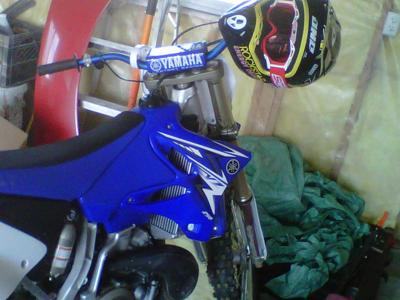 Blue and White 2009 Yamaha YZ 250 2 Stroke Dirt Bike w Renthal fatbars (this motorcycle is for example only; please contact seller for pics of the actual bike for sale)
