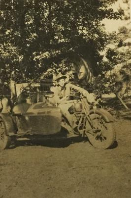 A Picture of My Dad on His Motorcycle in 1940.  Is it a Harley or??