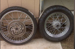 A brand new 180x16 rear wheel and tire spoked avon tire