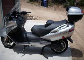 Silver 2005 Suzuki Burgman motor scooter AN 650 Givi Top Box
